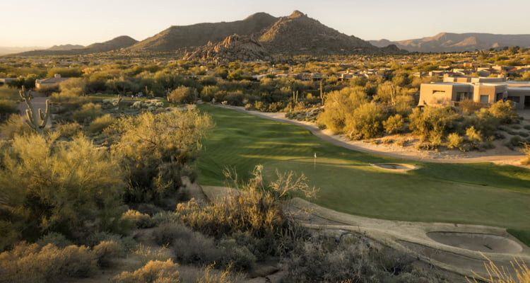 phoenix golf course with some desert landscape and mountainous background