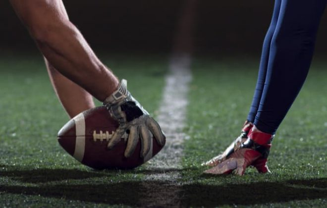 two football players at kick off